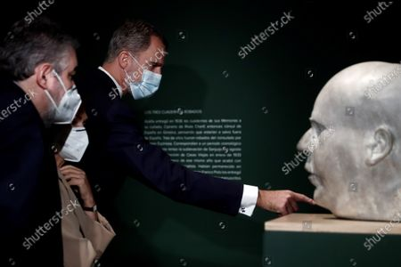 Stock Photo of Spain's King Felipe VI (R) attends the opening of an exhibition to mark the 80th anniversary of the death of Spanish late President of the Spanish Second Republic Manuel Azana at National Library, in Madrid, Spain, 17 December 2020, together with Spanish Culture Minister, Jose Manuel Rodriguez Uribes (L), and First Deputy Prime Minister, Carmen Calvo (C).