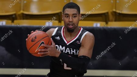 Stock Photo of Omaha guard Sam'i Roe (0) in the first half of an NCAA college basketball game, in Boulder, Colo