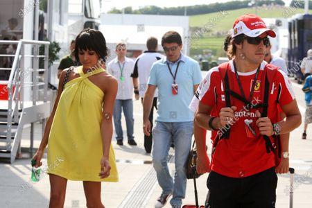 Fernando Alonso (ESP) Ferrari with his wife Raquel del Rosario (ESP) wife of Fernando Alonso (ESP) Ferrari. Formula One World Championship, Rd 12, Hungarian Grand Prix, Qualifying Day, Budapest, Hungary, Saturday 31 July 2010.