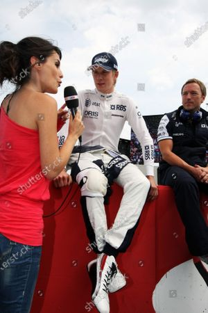 Nico Hulkenberg (GER) Williams on the grid is interviewed by Marion Jolles (FRA) TF1 TV Presenter. Formula One World Championship, Rd 11, German Grand Prix, Race, Hockenheim, Germany, Sunday 25 July 2010.