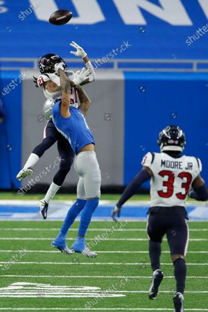 Detroit Lions wide receiver Marvin Jones (11) is defended by Houston Texans cornerback Bradley Roby (21) during an NFL football game, in Detroit