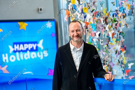 Designer Charles Kaisin poses for the photographer at the inauguration by designer Kaisin and CEO of Engie Benelux Van Troeye of a collective and participatory work of ENGIE employees, in Brussels, Thursday 17 December 2020. ENGIE employees in Belgium have folded more than 20,000 recycled paper origami in just one month. For each origami, the ENGIE Foundation donates 0,50 euro to three associations approved by these same employees; a total of 10.331 euro to support SOS Children's Villages, Growing otherwise with AD / HD and La Maison d'Enfants Reine Marie-Henriette.
