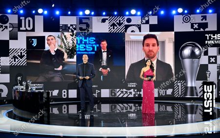 From left on the screen: Portugal's Cristiano Ronaldo, Poland's Robert Lewandowski and Argentina's Lionel Messi wait for hosts Reshmin Chowdhury, right, former Dutch soccer player Ruud Gullit, left, to announce the best player award during the Best FIFA Football Awards Ceremony in Zurich, Switzerland