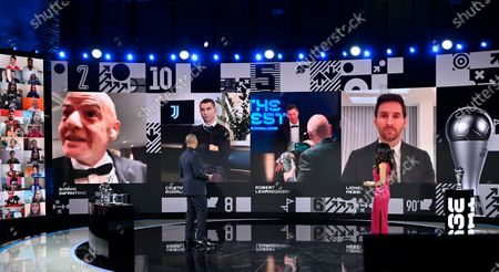 Hosts Reshmin Chowdhury, right, and former Dutch soccer player Ruud Gullit, left, announce the best player award to Poland's Robert Lewandowski who receives from FIFA President Gianni Infantino during the Best FIFA Football Awards Ceremony in Zurich, Switzerland, . On the screen at second left is Cristiano Ronaldo and at right Lionel Messi