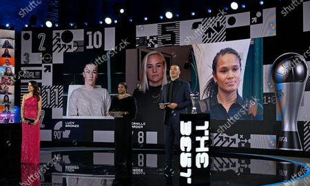 From left on the screen: England's Lucy Bronze, Denmark's Pernille Harder and Wendie Renard of France wait for the announcement of Best Women's player by hosts Reshmin Chowdhury, left, and former Dutch soccer player Ruud Gullit, during the Best FIFA Football Awards Ceremony in Zurich, Switzerland