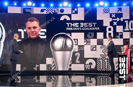 German goalkeeper Manuel Neuer on screen after being awarded Best Goalkeeper by hosts Reshmin Chowdhury, right, and former Dutch soccer player Ruud Gullit, left, during the Best FIFA Football Awards Ceremony in Zurich, Switzerland