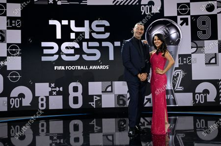 Hosts Reshmin Chowdhury, right, and former Dutch soccer player Ruud Gullit pose for a photo after the Best FIFA Football Awards Ceremony in Zurich, Switzerland