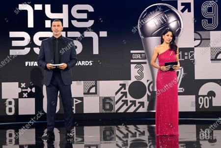 Hosts Reshmin Chowdhury, right, and former Dutch soccer player Ruud Gullit at the start of the Best FIFA Football Awards Ceremony in Zurich, Switzerland