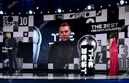German goalkeeper on screen after being awarded Best Goalkeeper by Manuel Neuer hosts Reshmin Chowdhury, right, and former Dutch soccer player Ruud Gullit at the start of the Best FIFA Football Awards Ceremony in Zurich, Switzerland