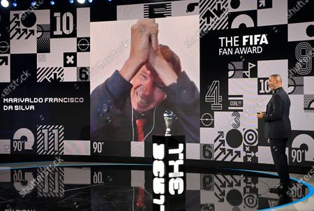Marivaldo Francisco da Silva celebrates on screen after host former Dutch soccer player Ruud Gullit announced that he had won the FIFA Fan Award during the Best FIFA Football Awards Ceremony in Zurich, Switzerland