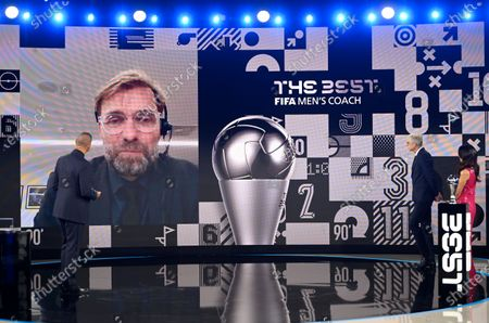 Liverpool's manager Jurgen Klopp speaks on screen to host Ruud Gullit after being awarded as Men's coach of the year during the Best FIFA Football Awards Ceremony in Zurich, Switzerland