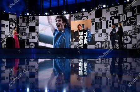 Hosts Reshmin Chowdhury, left, and former Dutch soccer player Ruud Gullit during a homage to the recently deceased Italian soccer legend Paolo Rossi during the Best FIFA Football Awards Ceremony in Zurich, Switzerland
