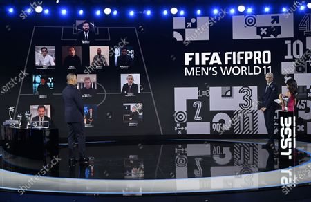 Stock Photo of The hosts Reshmin Chowdhury (R) and Ruud Gullit (L) and guest Arsene Wenger present the FIFA FIFPRO Men's World 11 during the the Best FIFA Football Awards virtual TV show broadcast from the FIFA headquarters in Zurich, Switzerland, 17 December 2020.