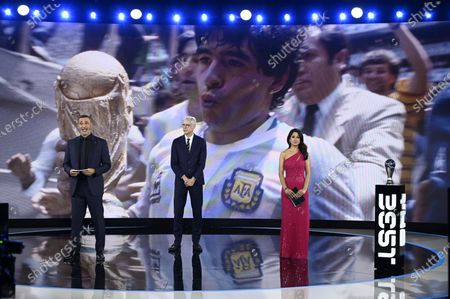 Stock Picture of The hosts Reshmin Chowdhury (R) and Ruud Gullit (L) and guest Arsene Wenger remember later Argentinian player Diego Armando Maradona during the the Best FIFA Football Awards virtual TV show broadcast from the FIFA headquarters in Zurich, Switzerland, 17 December 2020. Maradona died 25 November 2020 aged 60.