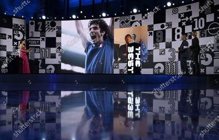 Stock Image of A picture of late Italian player Paolo Rossi is shown during the Best FIFA Football Awards virtual TV show broadcast from the FIFA headquarters in Zurich, Switzerland, 17 December 2020. Rossi died 09 December 2020 at the age of 64