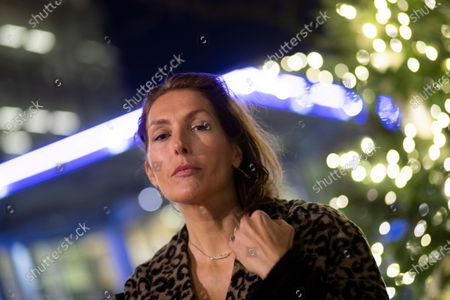 Former model Thysia Huisman, who is among women who have accused Jean-Luc Brunel, a modeling agent associated with disgraced U.S. financier Jeffrey Epstein of rape, poses for a picture in Amsterdam, Netherlands, . The Paris prosecutors office said Thursday that Brunel was detained Wednesday, suspected of an array of crimes, including the rape of minors and human trafficking for sexual exploitation. Brunel was being investigated as part of a broad French probe into alleged sexual exploitation of women and girls by Epstein and his circle