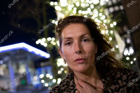 Former model Thysia Huisman, who is among women who have accused Jean-Luc Brunel of rape, poses for a picture in Amsterdam, Netherlands, . The Paris prosecutors office said Thursday that Brunel, a modeling agent associated with disgraced U.S. financier Jeffrey Epstein, was detained Wednesday, suspected of an array of crimes, including the rape of minors and human trafficking for sexual exploitation. Brunel was being investigated as part of a broad French probe into alleged sexual exploitation of women and girls by Epstein and his circle