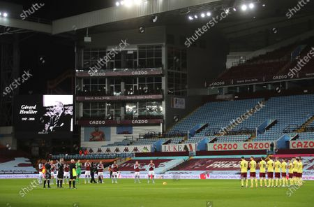 Players of both teams observe a minute of applause as they pay their respects to former Aston Villa manager Gerard Houllier ahead of the English Premier League soccer match between Aston Villa and Burnley at Villa Park stadium in Birmingham, England