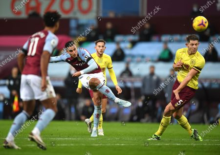 Aston Villa's Anwar El Ghazi kicks the ball ahead of Burnley's James Tarkowski, right, during the English Premier League soccer match between Aston Villa and Burnley at Villa Park stadium in Birmingham, England