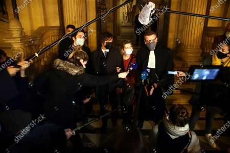 French-American Mark Moogalian, center right, his wife Isabelle, center, and his lawyer Thibault de Montbrial, center right, answer to media at the end of the Thalys attack trial, at the Paris courthouse, . A French court has convicted an Islamic State operative in a train attack five years ago that was foiled with a dramatic tackle by three American passengers. The court on Thursday sentenced Moroccan-born Ayoub El Khazzani to life in prison, with 22 years guaranteed behind bars