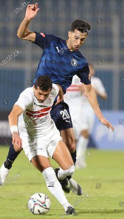 Zamalek player Tarek Hamed (L) in action against Pyramids  player Mahmoud Hamada (R) during the Egyptian Premier League soccer match Pyramids vs Zamalek in Cairo, Egypt, 17 December 2020.