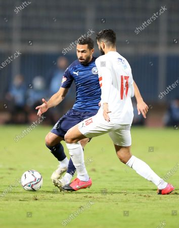 Zamalek player Ferjani Sassi  (R) in action against Pyramids  player Ahmed Fathi (L) during the Egyptian Premier League soccer match Pyramids vs Zamalek in Cairo, Egypt, 17 December 2020.