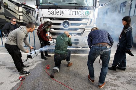 Michel Comte (SUI) Photographer shoots some trainers on a Safety Truck. Formula One Testing, Day Two, Jerez, Spain, Thursday 11 February 2010.