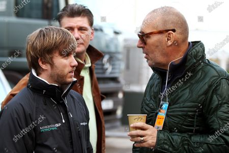 Nick Heidfeld (GER) Mercedes GP Third Driver talks with Michel Comte (SUI) Photographer. Formula One Testing, Day Two, Jerez, Spain, Thursday 11 February 2010.