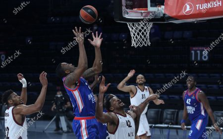Stock Picture of James Anderson (C) of Anadolu Efes in action against  Kyle Hines (R) of AX Armani Exchange Milan during the Euroleague basketball match between Anadolu Efes vs AX Armani Exchange Milan at Sinan Erdem Arena in Istanbul, Turkey, 17 December 2020.