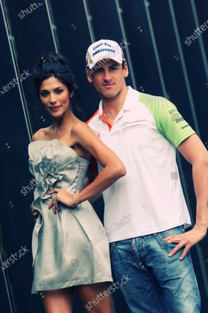 Adrian Sutil (GER) Force India F1 with Pia Miller (AUS) Australian Grand Prix Ambassador. Formula One World Championship, Rd 2, Australian Grand Prix, Preparations, Albert Park, Melbourne, Australia, Wednesday 24 March 2010. Note: This image has been digitally altered from the original, which is also available on the archive. (d10aus17.jpg)