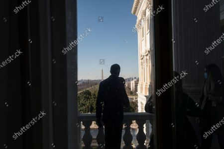 United States Senator John Thune (Republican of South Dakota) poses for photos with staff members on the Senator Bob Dole Balcony at the U.S. Capitol in Washington, DC,.