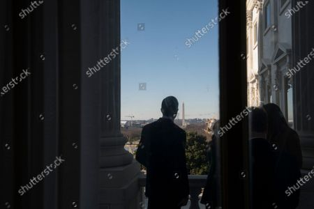 Editorial photo of United States Senator John Thune (Republican of South Dakota) poses for photos with staff members on the Senator Bob Dole Balcony at the U.S. Capitol - 17 Dec 2020