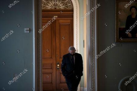 United States Senator Bob Menendez (Democrat of New Jersey) walks alone in the hallway outside the Senate chamber following a private conversation with United States Senator Lindsey Graham (Republican of South Carolina) at the U.S. Capitol in Washington, DC,.
