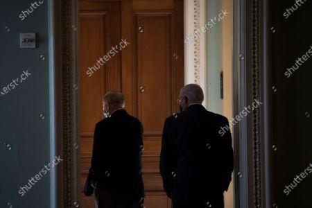United States Senator Lindsey Graham (Republican of South Carolina), left, walks with United States Senator Bob Menendez (Democrat of New Jersey), right, for a private conversation at the U.S. Capitol in Washington, DC,.