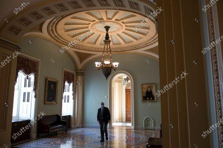 United States Senator Lindsey Graham (Republican of South Carolina) walks alone in the hallway outside the Senate chamber following a private conversation with United States Senator Bob Menendez (Democrat of New Jersey) at the U.S. Capitol in Washington, DC,.