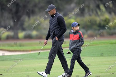 Tiger Woods, left, and his son Charlie walk on 12th fairway during a practice round of the Father Son Challenge golf tournament, in Orlando, Fla