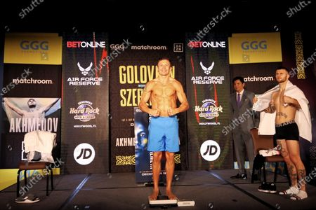 Polish middleweight boxer Kamil Szeremeta (R) and Kazakhstan's Gennady Golovkin (C) pose for photographers during the official weighing meeting in Hollywood, Florida, USA, 17 December 2020. Szeremeta will fight Golovkin in their IBF Middleweight World Championship title bout on 18 December 2020.