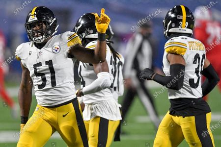 Pittsburgh Steelers linebacker Avery Williamson (51) celebrates a defensive stop against the Buffalo Bills during the first half of an NFL football game in Orchard Park, N.Y