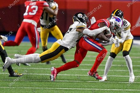 Buffalo Bills wide receiver Stefon Diggs (14) is tackled by Pittsburgh Steelers linebacker Marcus Allen (27) and cornerback Cameron Sutton (20) during the first half of an NFL football game in Orchard Park, N.Y
