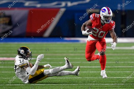 Buffalo Bills running back Zack Moss (20) breaks away from Pittsburgh Steelers linebacker Marcus Allen (27) during the second half of an NFL football game in Orchard Park, N.Y