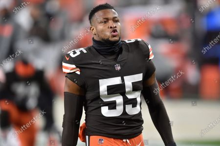 Cleveland Browns linebacker Tae Davis reacts before an NFL football game against the Baltimore Ravens, in Cleveland. The Ravens won 47-42