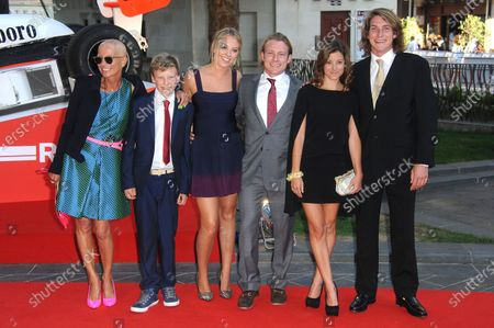 Tom Hunt (GBR) (middle) and Freddie Hunt (GBR) (right) with their mother Sarah Lomax (GBR) (left) and her son Charlie from her subsequent marriage (second left). Rush Film Premiere, Odeon Leicester Square, Leicester Square, London, 2 September 2013.