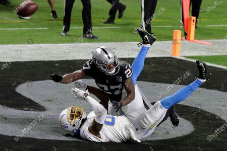 Las Vegas Raiders cornerback Trayvon Mullen (27) commits a pass interference on Los Angeles Chargers wide receiver Mike Williams (81) during the second half of an NFL football game, in Las Vegas