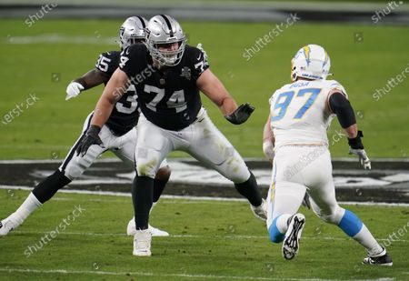 Stock Image of Las Vegas Raiders offensive tackle Kolton Miller #74 blocks Los Angeles Chargers defensive end Joey Bosa #97 during the first quarter in an NFL football game, in Las Vegas