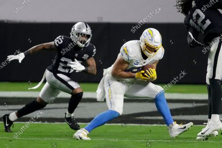 Stock Photo of Los Angeles Chargers tight end Hunter Henry (86) makes a catch before running in for a touchdown against Las Vegas Raiders cornerback Keisean Nixon (22) during the first half of an NFL football game, in Las Vegas