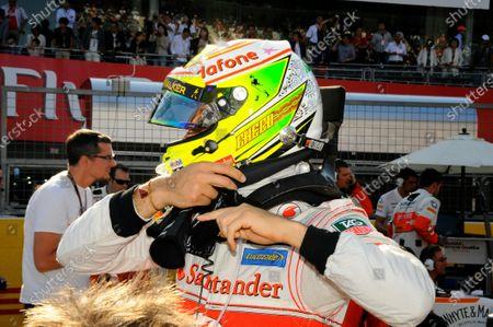 A star in tribute to Maria de Villota (ESP) on the helmet of Sergio Perez (MEX) McLaren. Formula One World Championship, Rd15, Japanese Grand Prix, Race Day, Suzuka, Japan, Sunday 13 October 2013.