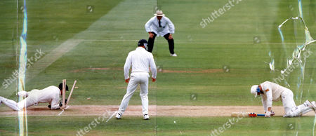 Michael Atherton England Cricketer On His Knees After Being Run-out For 99 In The Second Ashes Test Against Australia At Lords.the Wicketkeeper Is Ian Healy.this Picture Is A Join-up The Right Hand Side(the Batsman)is A Daily Mail- Ted Blackbrow Picture And The Left Hand Side Is A Graham Morris Picture