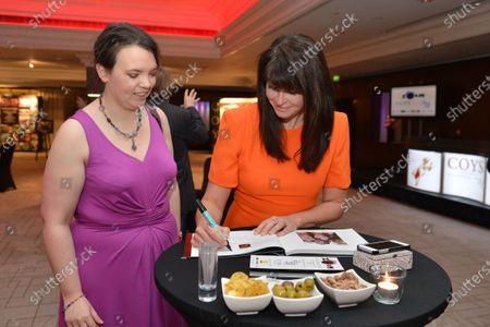 (L to R): Caroline Reid (GBR) Formula Money, and Suzi Perry (GBR) BBC Sport. Zoom Auction in aid of Great Ormond Street Hospital, Intercontinental Park Lane Hotel, London, Friday 7 February 2014.