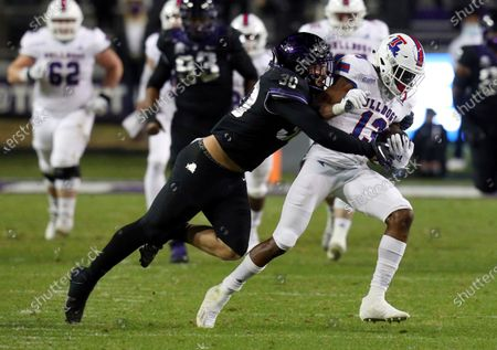 Linebacker Garret Wallow (30) tackles Louisiana Tech wide receiver Isaiah Graham (13) during an NCAA college football game