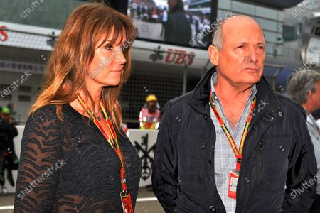 R-L: Ron Dennis (GBR) McLaren Executive Chairman and his girlfriend Carol Weatherall (GBR) on the grid. Formula One World Championship, Rd4, Chinese Grand Prix, Race, Shanghai, China, Sunday 20 April 2014.